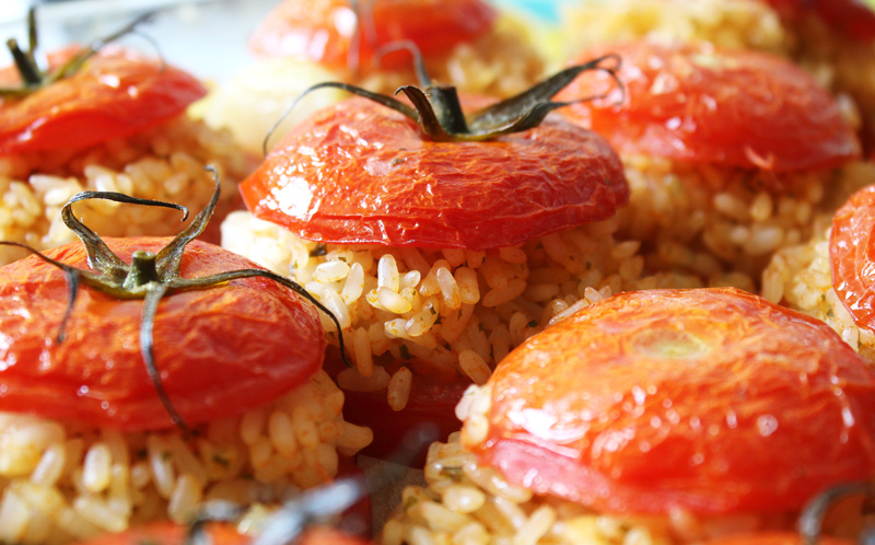 Baked stuffed tomatoes brim with rice infused with the tomato's own juices, garlic and herbs.