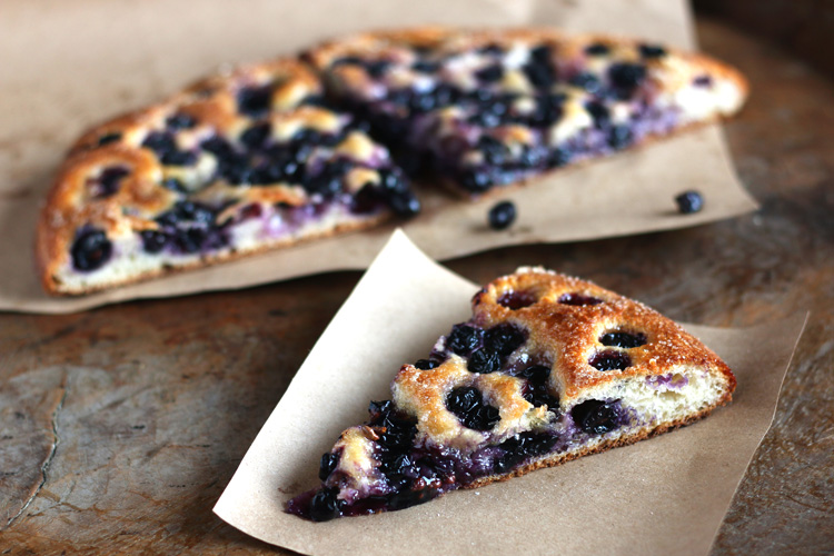 Tuscan Grape Focaccia - Schiacciata con l'uva: A sweet wine harvest flatbread from Tuscany made with layers of bread dough filled and topped with wine harvest grapes and sugar. When baked, the grapes and sugar meld together to create a jammy center with crunchy seeds. Simply deliziosa!