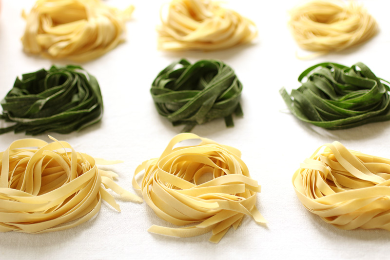 Straw and Hay Pasta is made from half handmade egg dough and half spinach dough that is rolled thin, cut into long ribbons and rolled into delicate nests to dry.